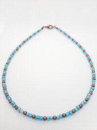 Minimalischtische ketting met blauwe rocailles en koperkleurige kraaltjes