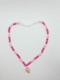 Kinderketting, roze en wit, acrylkralen, hartje, geregen op elastiek